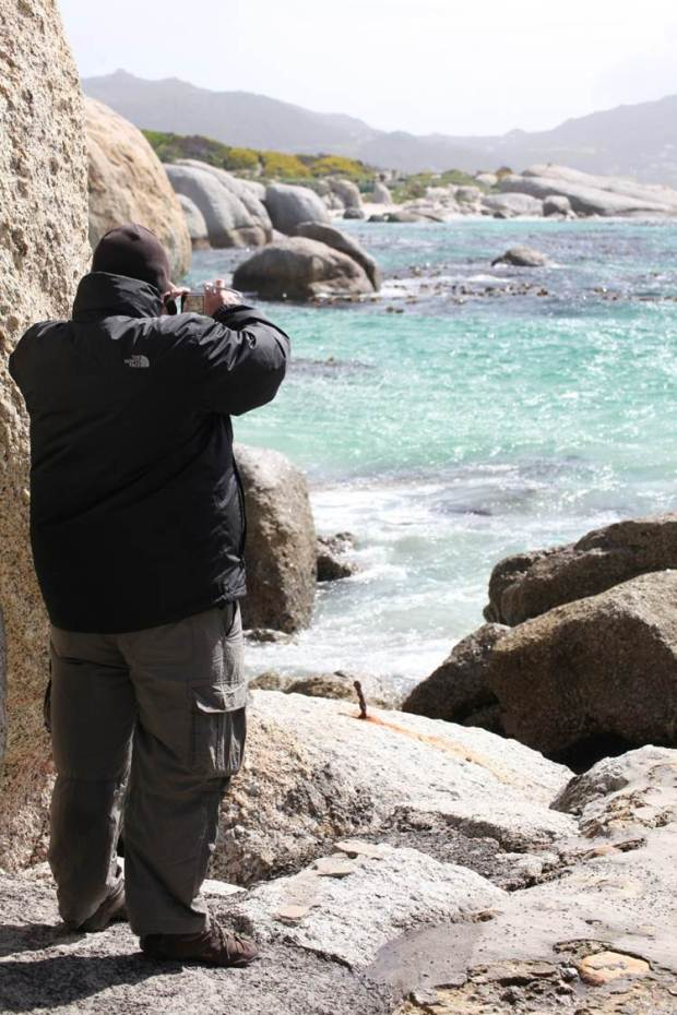 My husband scans Boulders Bay in S.Africa for penguins.