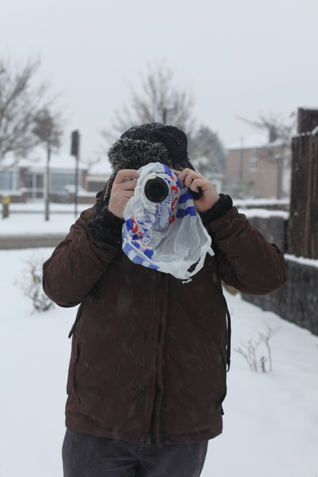 The snow can't get me! My friend Sam wrapped up warm with his Canon protected from the snow.