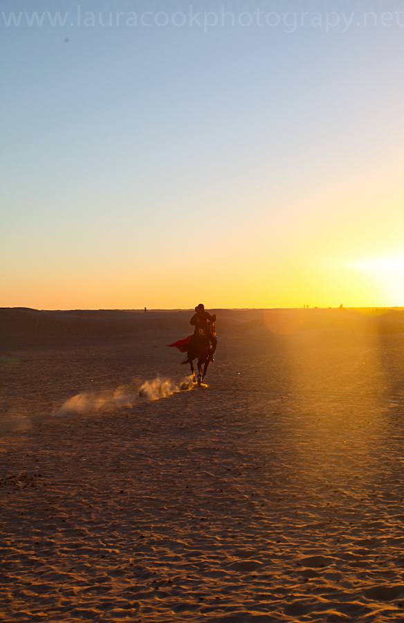 Kicking up dust in the desert under beautiful sunset light.