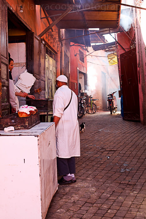 Many locals stop to chat at the various stalls and food shops around the souks.