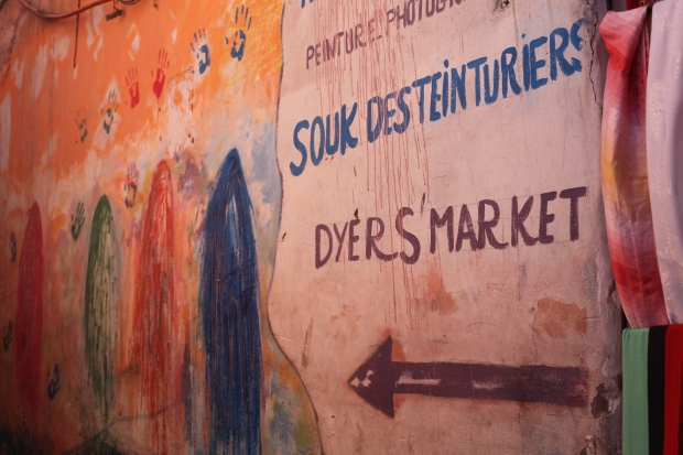 A bright and cheerful sign points the way in the heart of the traditional bazaar of Marrakech
