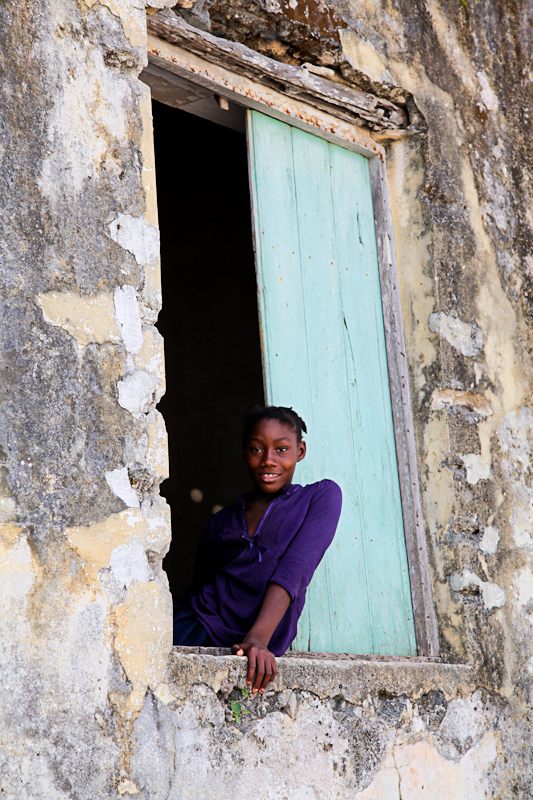 The 'natural smile'. The best kind of smile. This girl was just sat in her window smiling at the world going by (taken in Mozambique in 2013)
