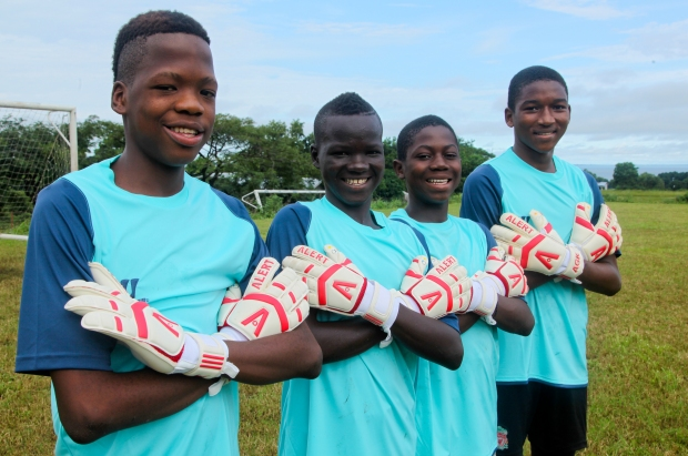 John Fillie, , Brima Kamara, Ahmed Tailu Mannah and Alusine Barrie  show off their Alert goalkeeping gloves