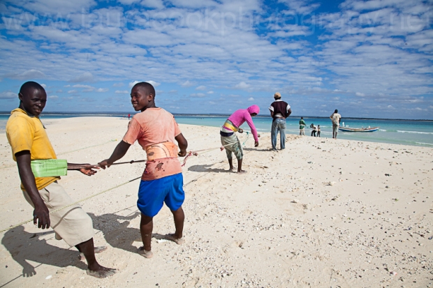 We shared the beaches with very few locals.. Here are some island fishermen pulling in a healthy catch.