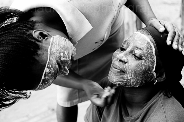Women on Ibo Island applying the traditional muciro face mask.