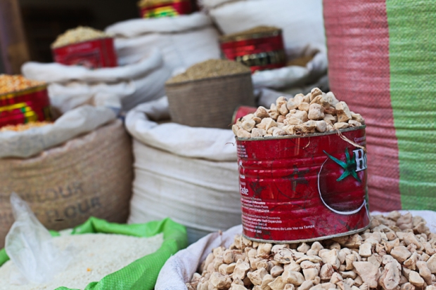 Spices stacked up high in the market.