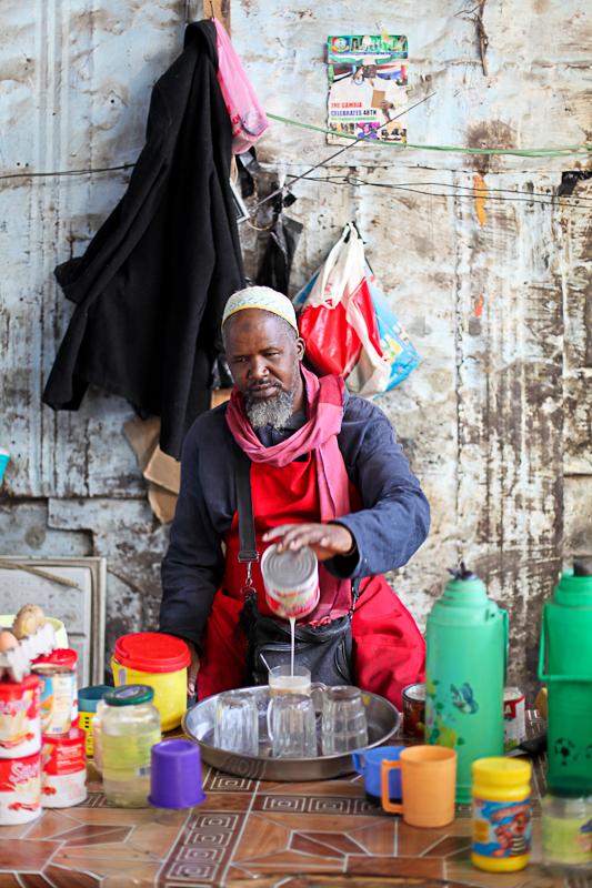 The breakfast seller makes porridge for early morning shoppers