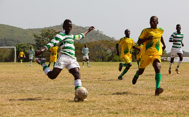 CBF Academy Captain Umaru Samura powers through to take possession.