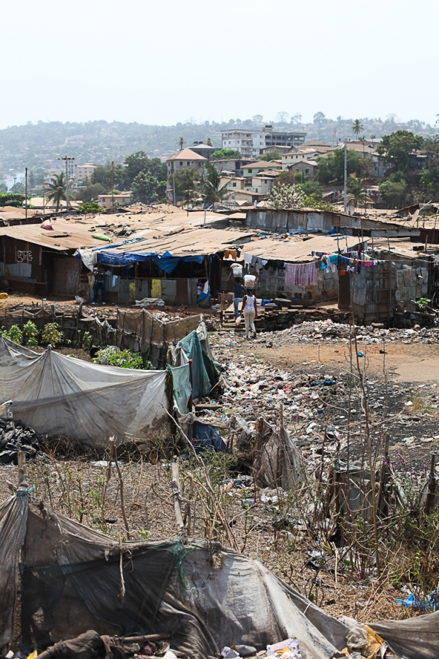 Homes and businesses operate alongside the rubbish dump