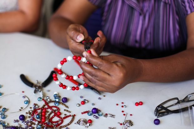 Therapeutic opportunities are plenty. Here a group of girls use beads to make necklaces and bracelets.
