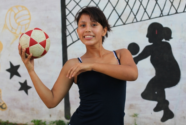 Sport is another key way of engaging and encouraging the young people. Here Alondra (a member of Team Nicaragua's female team) holds a football aloft.