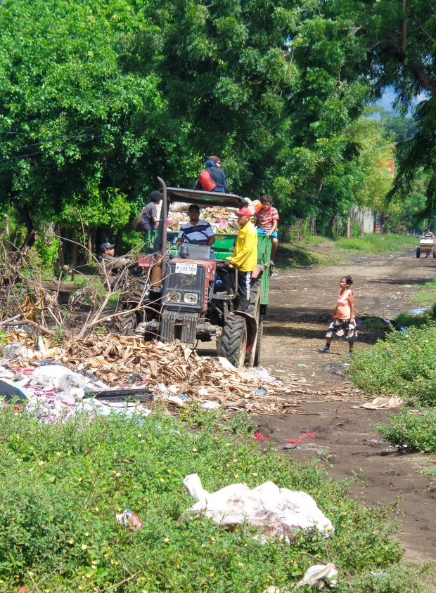 Children on the streets in Nicaragua are vulnerable to all sorts of risks. These children are looking for valuable things to sell and jump on and off rubbish trucks.