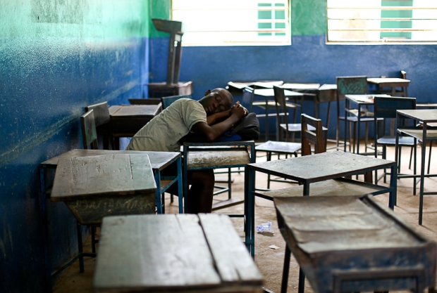 Resting his head in between lessons in Freetown, Sierra Leone.
