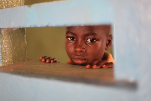 Mohamed stares into one of the classrooms at The National School for the Deaf in Freetown.