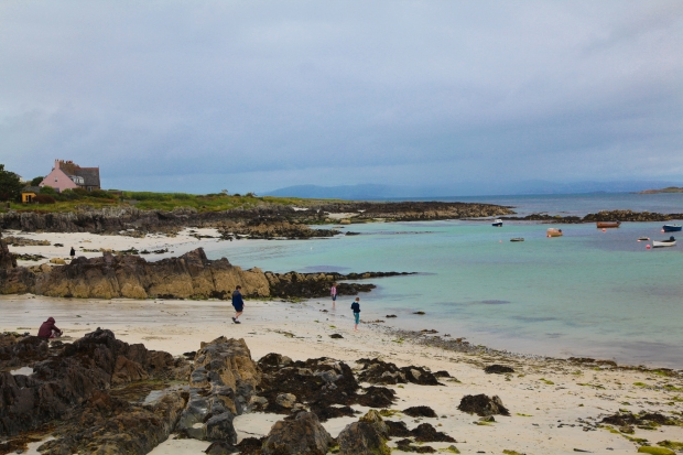 Beach next to the ferry port on Iona. Children bravely play in the cold Atlantic water. It looks beautifully blue but is very cold!