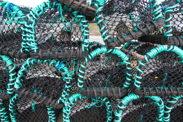 Colourful lobster pots by the Iona ferry port on the Isle of Mull