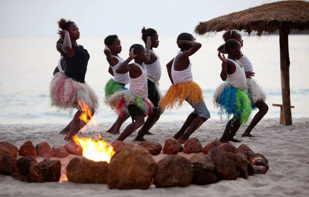 Simple beauty of a campfire and local children dancing Shot on location at The Place, Tokeh Beach, Sierra Leone.