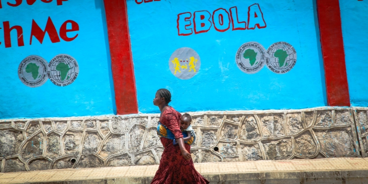 Colourful walls that once advertised washing soap now promote Ebola health messages in Freetown
