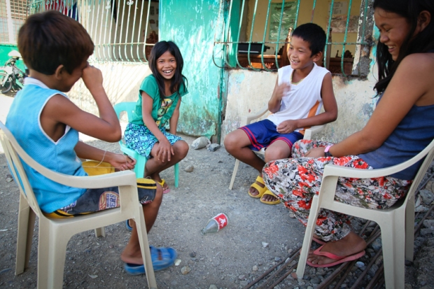 A very innocent version of Spin the Bottle - if it lands on you three times then you are out the game. Being played in Parina Barangay, Giporlos, The Philippines.