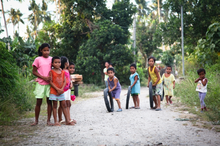 Children playing in Dulag, The Philippines. Racing hoops!