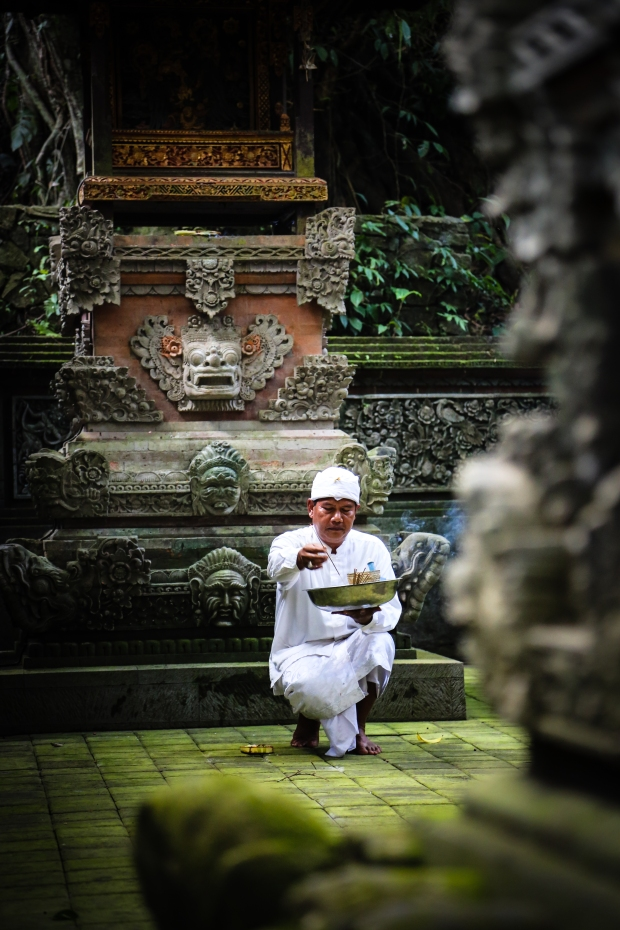 Priest preparing the Pura Beji Temple within the Monkey Forest in Ubud.