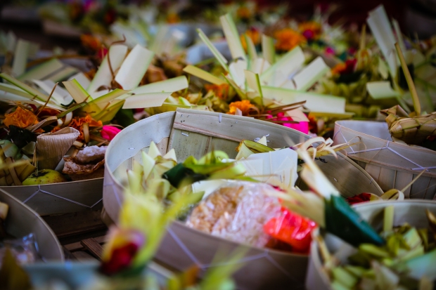 During the days before the ceremony offerings of fruit, rice and flowers are prepared by the women.